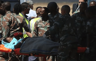 Members of the South African Army transport a pilgrim, who sustained injuries in a collapsed church guesthouse in Lagos and was evacuated from Nigeria, upon arriving at an air force base north of Johannesburg. File photo Image by: SIPHIWE SIBEKO / REUTERS