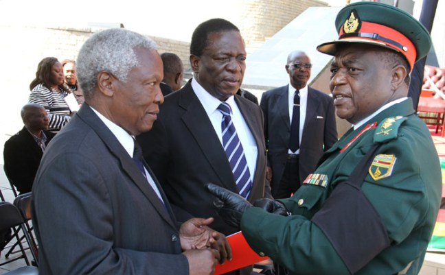 Minister of Justice, Legal and Parliamentary Affairs Emmerson Mnangagwa (centre), Minister of Defence Sydney Sekeramayi chat to Commander Zimbabwe Defence Forces Constantine Chiwenga (Picture by Kudakwashe Hunda)