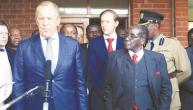 Russian Foreign Minister Sergei Lavrov (L) and Zimbabwean President Robert Mugabe