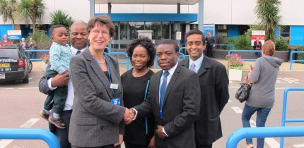 Dr Blessing Zamba being welcomed at Colchester hospital by the CEO ,Dr Lucy Moore. Behind Dr Zamba is Dr Vithian, consultant Endocrinology and Diabetes , who is supervising the placement. Also in the picture is the Hazel and Jeff Sango and son Murishe. The family negotiated the placement and also the Commonwealth fellowship.