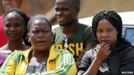 Neighbours of Kelly Khumalo, Meyiwa's girlfriend, gathered outside her house