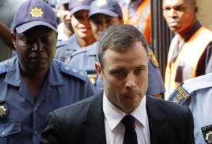 South African Olympic and Paralympic sprinter Oscar Pistorius arrives at the North Gauteng High Court in Pretoria