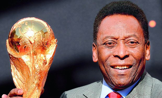 Brazilian football legend Pele poses with the FIFA World Cup in Paris