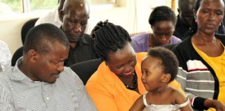 Mr Eric Kamanzi shares a light moment with his daughter Arnella Kamanzi together with her mother Angela Mbabazi at the police headquarters in Kampala yesterday. Photo by Michael Kakumirizi