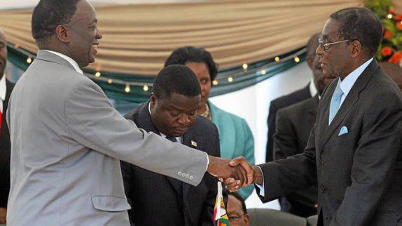 Frosty Relations?: Mnangagwa shakes Mugabe's hand