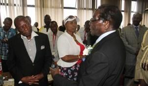 President Mugabe chats with Nicholas Goche before the Politburo meeting at the Zanu-PF Headquarters in Harare on Saturday. (Picture: Kudakwashe Hunda)