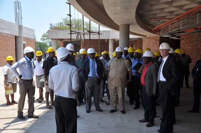 Minister Obert Mpofu (in khaki suit) and other officials during a tour of Victoria Falls Airport on Monday