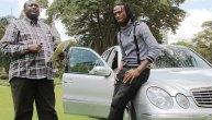Esau Mupfumi handing over a Mercedes to singer Jah Prayzah
