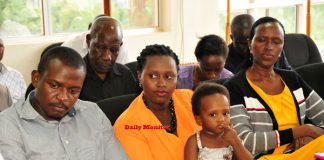 The Kamanzi family with their daughter