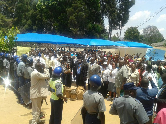 HUMAN BARRICADE: Anti-riot police block a group of war veterans and youths who were demonstrating for the ouster of Ray Kaukonde and his Zanu PF Mashonaland East provincial executive in Marondera.