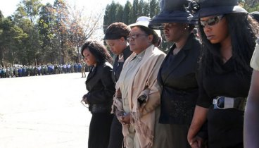 VP Joice Mujuru with her daughters during the funeral of her husband General Mujuru two years ago