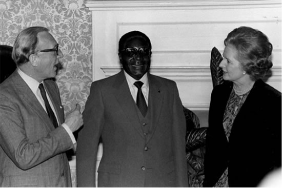 At the peak of butchering people in Matebeleland, Mugabe seen here on one of his hundreds of trips to London