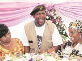 "Grace Mugabe shares a lighter moment with Dickson Chingaira ""Cde Chinx"" and outgoing Zanu-PF secretary for the Women's League Oppah Muchinguri"
