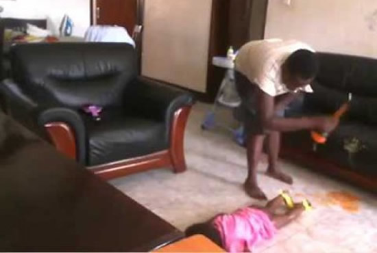 Jolly Tumuhirwe, a 22-year-old housemaid in Naalya in Kiwatule suburb, appears to be battering the baby with a hard object on the face.
