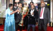 FOR KEEPS . . . Dynamos skipper Murape Murape (second from right) and club secretary Webster Chikengezha receive the replica Castle Lager Premier League trophy on Friday in recognition of their incredible run of winning the trophy four times on the bounce