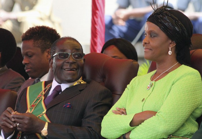 Zimbabwe's President Robert Mugabe and his wife Grace attend a Defence Force Day rally in Harare, August 12, 2014. REUTERS/Philimon Bulawayo