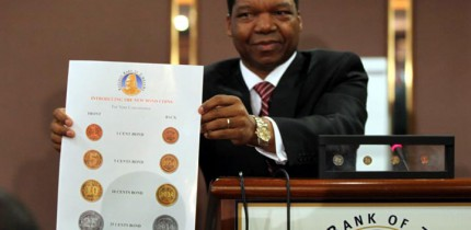 RBZ Governor, John Mangudya, unveiling new coins to the media.