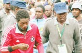 File Picture: A police officer escorts a man who was injured during a fight at the Soweto end of Barbourfields Stadium during the Region 5 Under-20 Youth Games closing ceremony in Bulawayo on Sunday