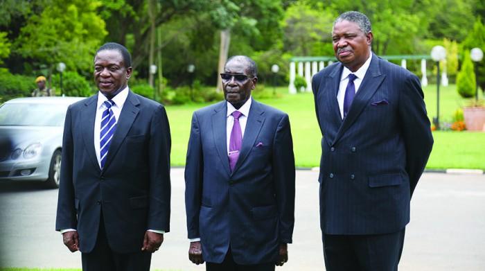 President Robert Mugabe, flanked by Vice-Presidents Emmerson Mnangagwa (L) and Phelekezela Mphoko