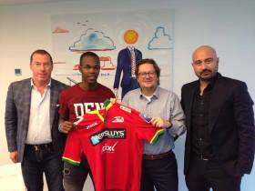 SIGNED AND SEALED . . . Zimbabwe international striker Knowledge Musona (second from left) holds the KV Oostende jersey with club chairman Marc Coucke (second from right), while his agent Paschalis Tountouris (right) looks on in Belgium yesterday