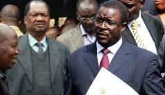 State media columnist Nathaniel Manheru — widely understood to be President Robert Mugabe's spokesperson George Charamba (right)