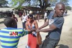 Touts scramble for a woman's bag at Mutoko bus terminus