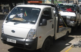 A vehicle being towed away in Harare