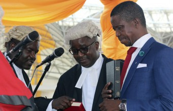 The Patriotic Front's Edgar Lungu, right, is sworn in as Zambia's president in Lusaka