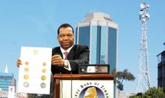RBZ governor, John Mangudya unveiling the bond coins