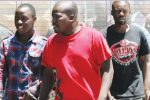 The convicted trio being escorted by detectives from the Magistrates' Court