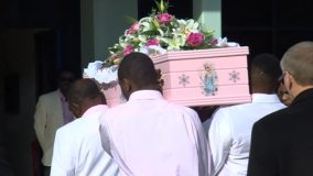 Mourners had been asked to dress in pink and white for the funeral