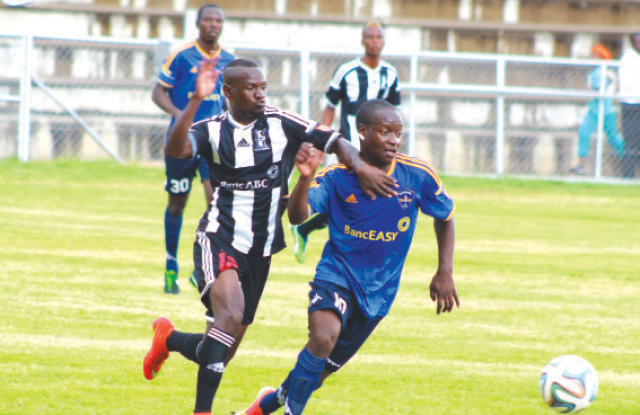 Highlanders FC winger Bruce Kangwa (left) and Chapungu's Lawrence ...