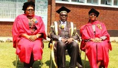 Dr Joice Mujuru and Dr Grace Mugabe on the day they got their PhD's seen seated here with President Mugabe (centre)