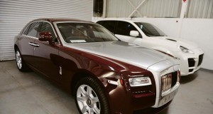 The Rolls-Royce Ghost that Zimbabwean property mogul Frank Buyanga bought in 2010, with Czech fugitive Radovan Krejcir's modified Porsche Cayenne behind it. Both cars went under the hammer this week with a host of other exotic vehicles seized by the taxman.