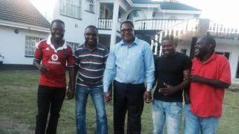 Energy Mutodi (centre) shows off his mansion