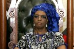 Zimbabwean First Lady Grace Mugabe listens to the address by President Robert Mugabe during the official opening of the last session of Zimbabwe's parliament on October 30, 2012 in Harare. (JEKESAI NJIKIZANA/AFP/Getty Images)