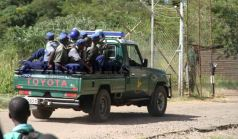 Members of the Police Support Unit drive into Chikurubi Maximum Security Prison to quell a food protest by prisoners