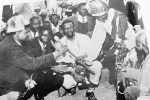 From left: the late VP Joshua Nkomo and President Mugabe with n'angas in the Zapu days before Independence.