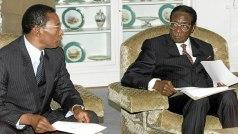 This file photo shows former Judge President Wilson Sandura meeting President Mugabe