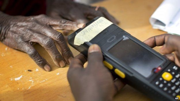 Voters have to validate their voting cards using a fingerprint reader