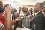 Journalists mob Econet lawyer Tawanda Nyambirai after an aborted Press breifing