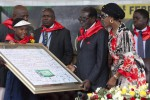 Zimbabwean President Robert Mugabe (C) receives a signed gift next to his wife Grace Mugabe (2nd R) on February 28, 2015 during the celebration of Mugabe's 91st birthday at Victoria Falls (AFP Photo/Jekesai Njikizana)