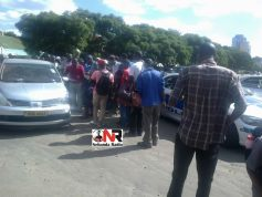 Drama as police spike car in Harare city centre
