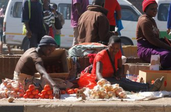 Vegetable vendors sell their wares along 4th street in Harare