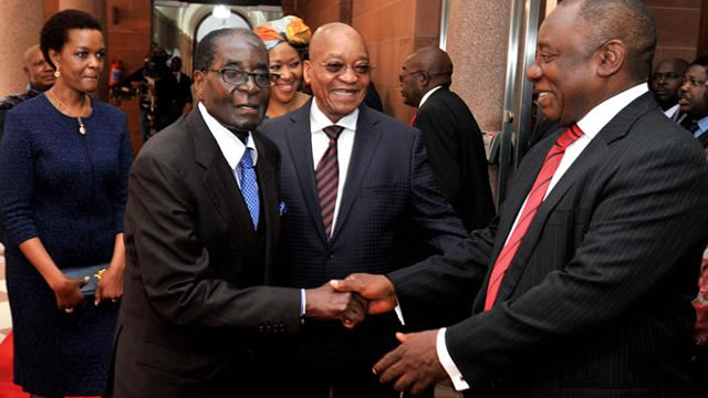 South African President Jacob Zuma and his deputy Cyril Ramaphosa receive Zimbabwean President Robert Mugabe and his wife Grace at the Union Buildings on his state visit on 8 April 2015. Picture: GCIS.