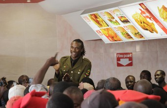 File Photo: Fans stampeding towards Jah Prayzah as he graced a Chicken Slice opening