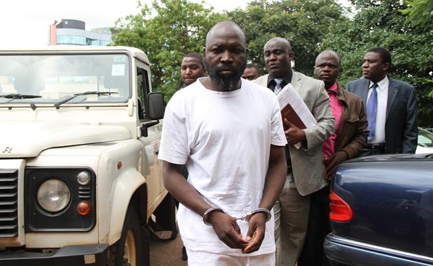 Madzibaba Ishmael Chokurongerwa Mufani arrives at the Harare Magistrates Court escorted by police detectives