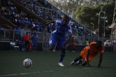 Dynamos Simba Nhivi works his way past Dongo Sawmill defender Khumbulani Njovo in yesterday's Premiership match at Rufaro. — (Picture by Innocent Makawa