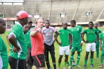 Caps United coach Mark Harrison (in red) stresses a point during a training session at the National Sports Stadium. (Picture by Eddie Muzerengi)