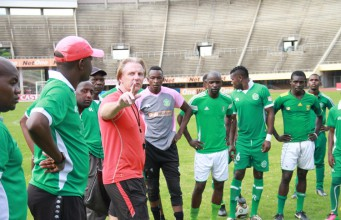 Caps United coach Mark Harrison (in red) stresses a point during yesterday's training session at the National Sports Stadium. (Picture by Eddie Muzerengi)